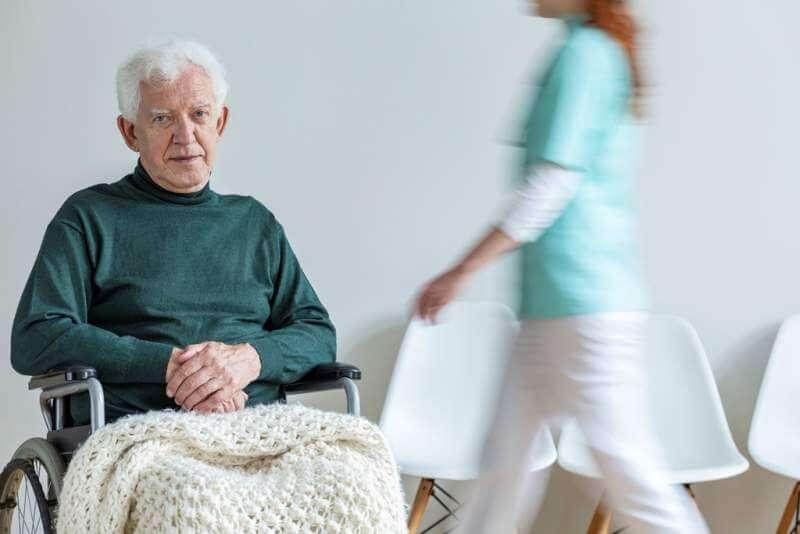 sad-paralyzed-elderly-man-in-the-wheelchair