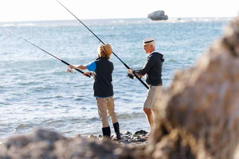 senior-man-fishing-with-his-grandson