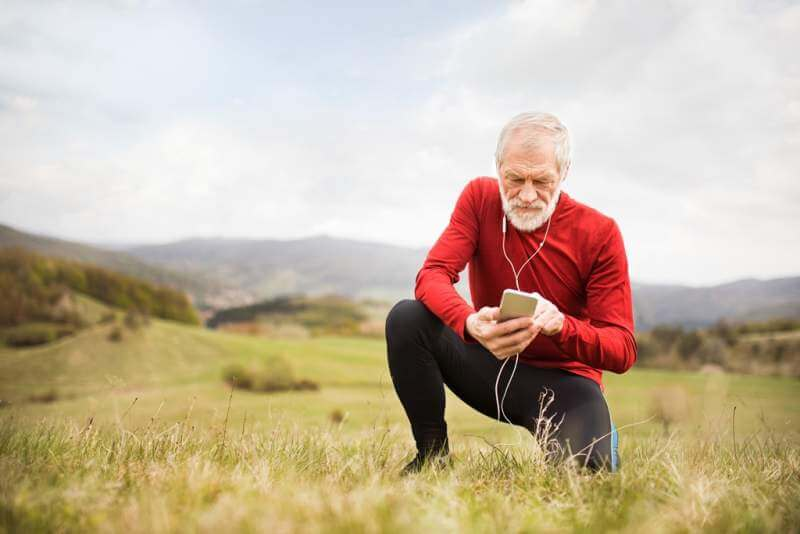active-senior-runner-in-nature-with-smart-phone