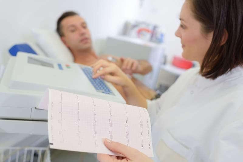 nurse-programming-heart-monitor-machine