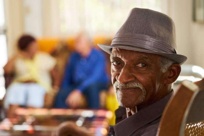 senior-black-man-with-hat-looking-at-camera