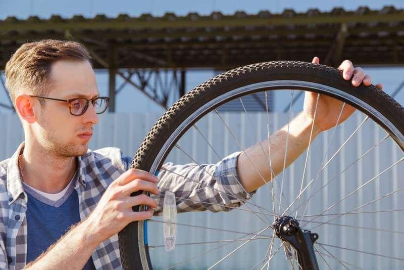 the-mechanic-man-repair-wheel-of-the-bicycle