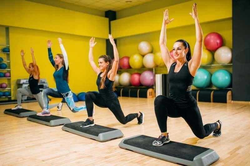 women-group-on-step-aerobic-training