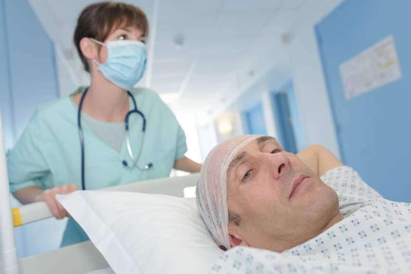 nurse-taking-patient-on-gurney-into-surgery