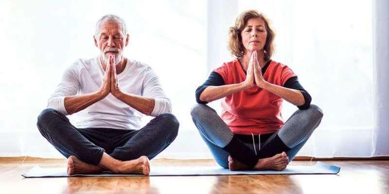 senior-couple-meditating-at-home