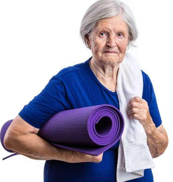 senior-woman-holding-yoga-mat