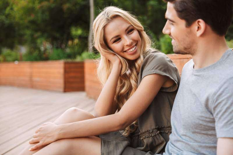 smiling-lovely-young-couple-talking-and-looking