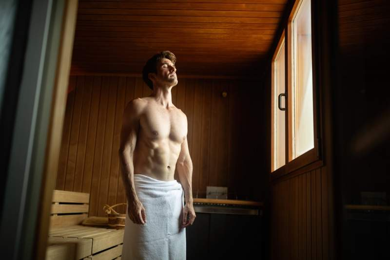 smiling-man-having-a-sauna-bath-in-a-steam-room