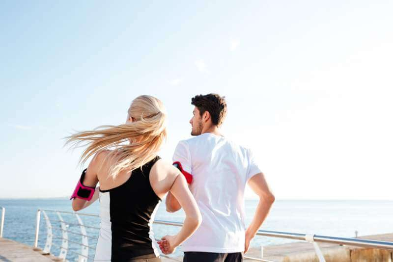 back-view-of-a-couple-exercising-for-marathon