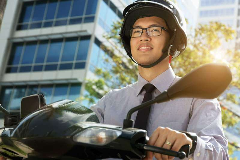 chinese-businessman-commuter-with-scooter