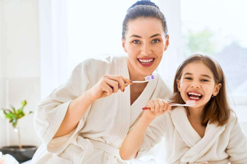 family-are-brushing-teeth