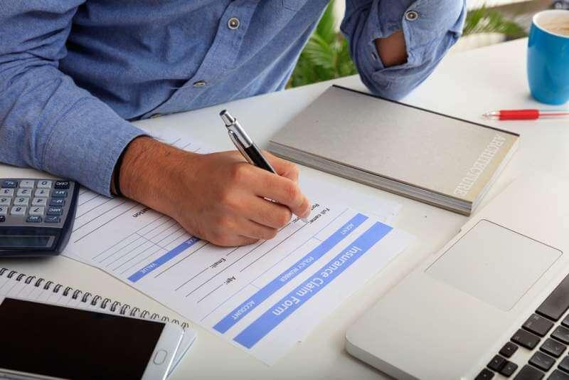 man-preparing-an-insurance-claim-form
