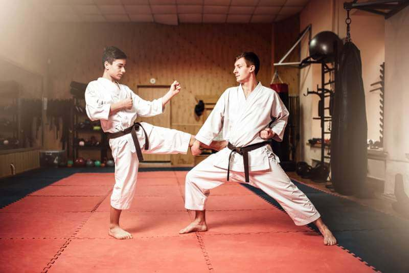martial-arts-masters-self-defence-practice-in-gym