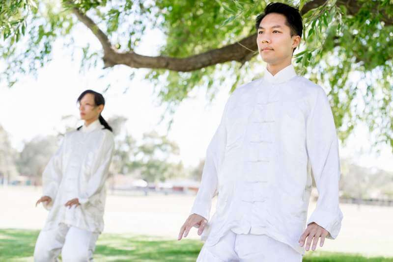 people-practicing-thai-chi-in-park
