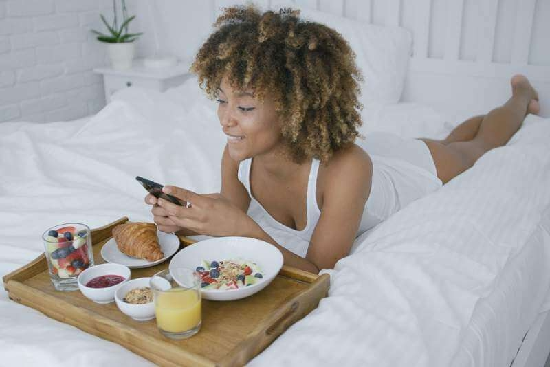 pretty-model-having-meal-in-bed