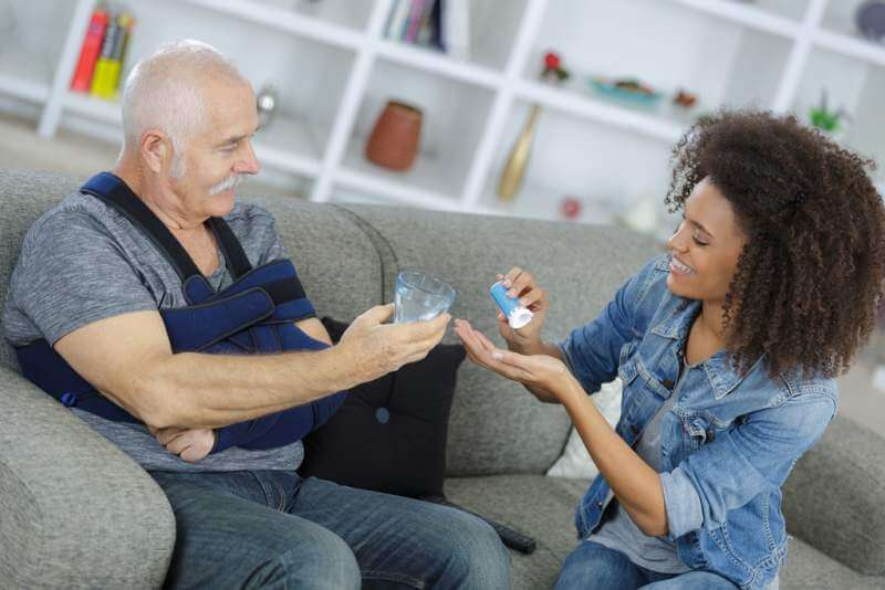 lady-preparing-medication-for-senior-man-with