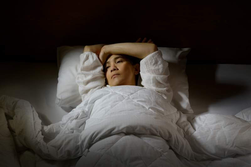 woman-with-insomnia-lying-in-bed-with-open-eyes