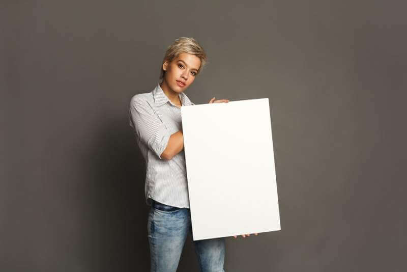 young-woman-with-blank-white-paper