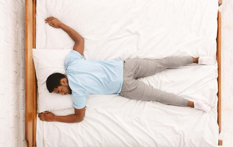 young-african-american-man-sleeping-in-bed-top