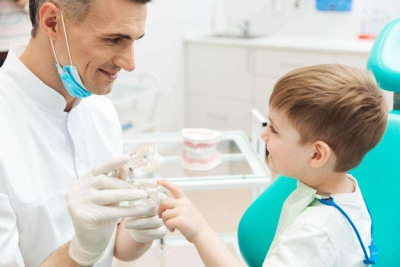 boy-on-cosultation-of-pediatrician-dentist-using