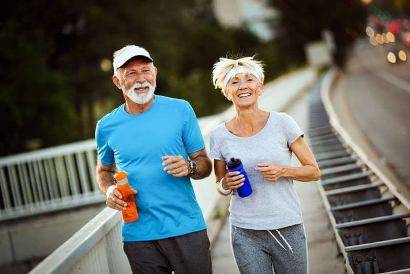 happy-senior-couple-staying-fit-by-sport-running