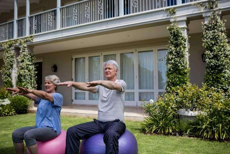 senior-couple-exercising-on-fitness-ball