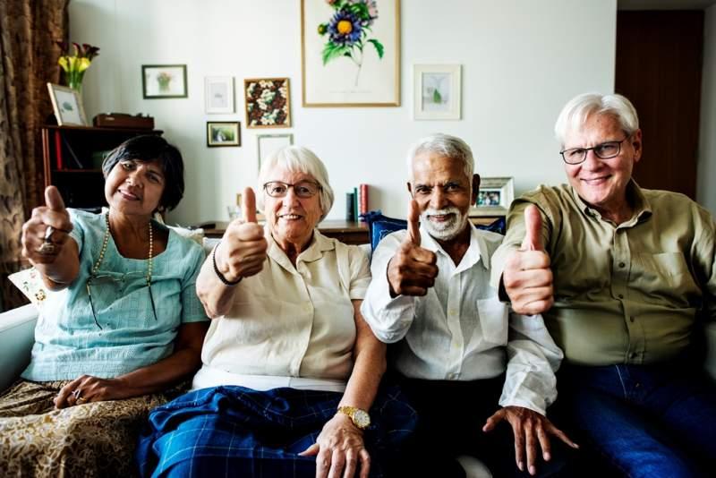 senior-friends-gesturing-thumbs-up
