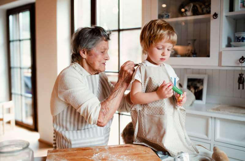 senior-grandmother-with-small-toddler-boy-making