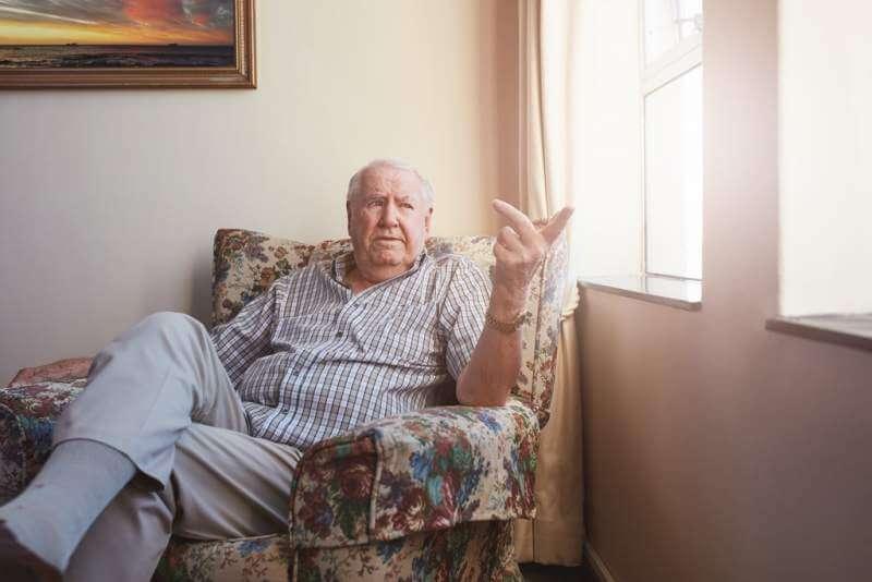 senior-man-sitting-at-assisted-living-facility