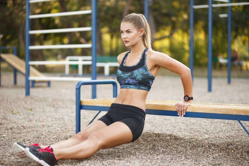 woman-doing-dips-workout