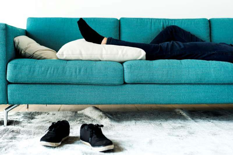 man-sleeping-on-the-sofa