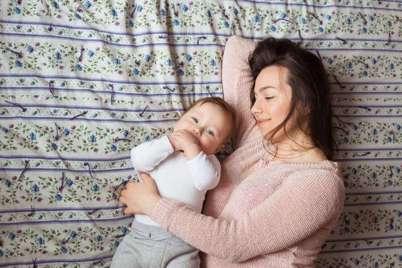 a-mother-and-baby-child-on-a-bed