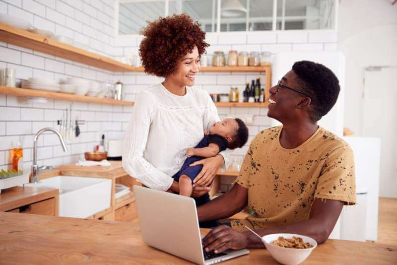 busy-family-in-kitchen-at-breakfast-with-father