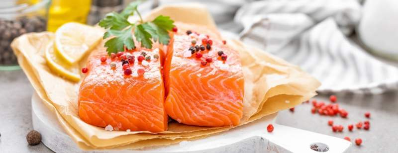 fresh-raw-salmon-fish-fillet-on-white-kitchen