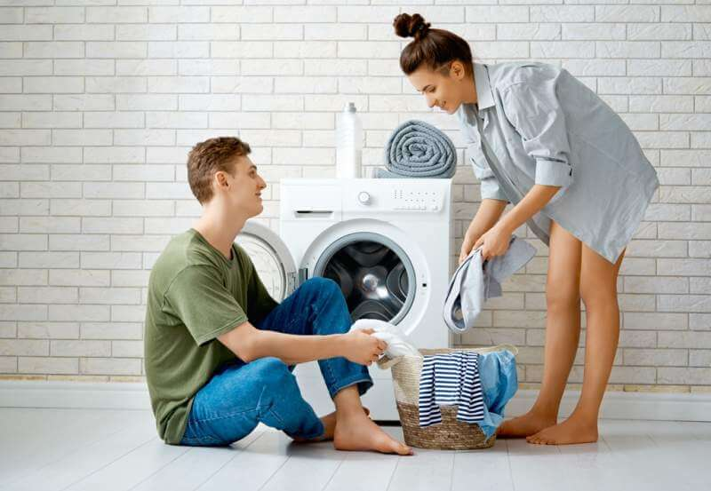 loving-couple-is-doing-laundry