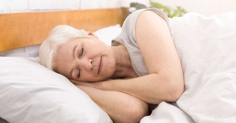 senior-woman-sleeping-in-bed-in-morning