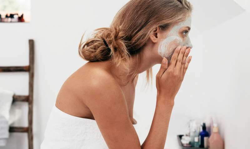 woman-taking-care-of-her-facial-skin