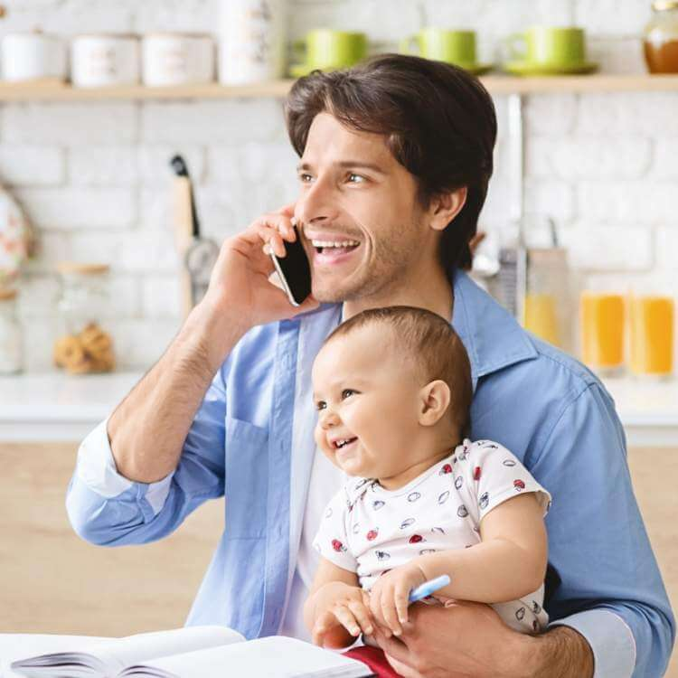 young-man-talking-on-phone-at-home-office
