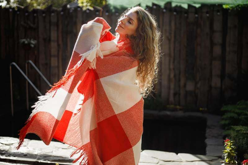 young-woman-is-standing-wrapped-in-a-red