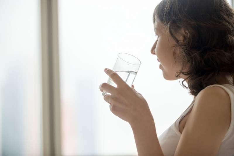 young-woman-with-glass-of-water
