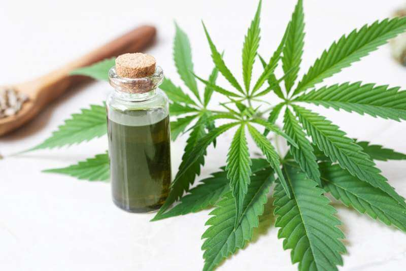 bottle-of-cbd-oil-and-leaves