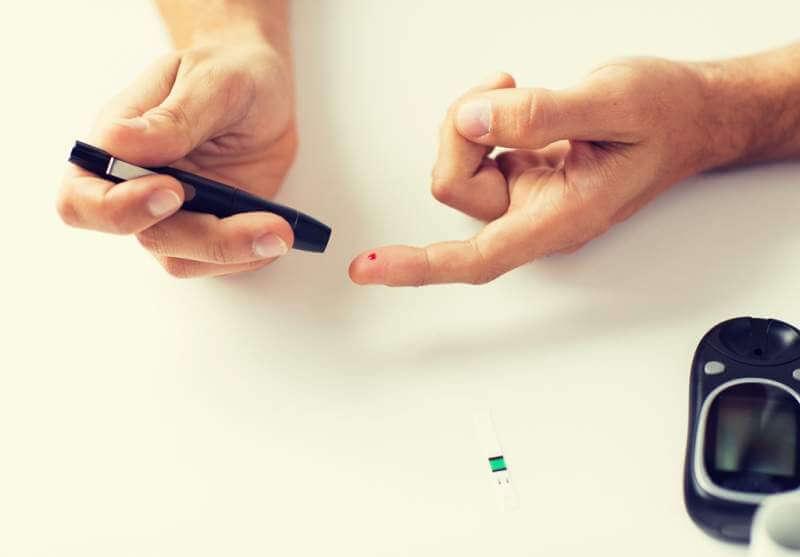 close-up-of-man-checking-blood-sugar