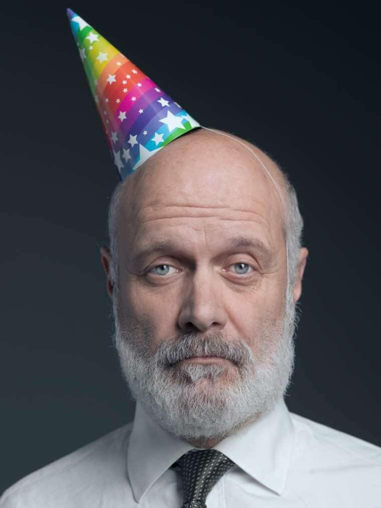 funny-senior-bald-man-with-party-hat