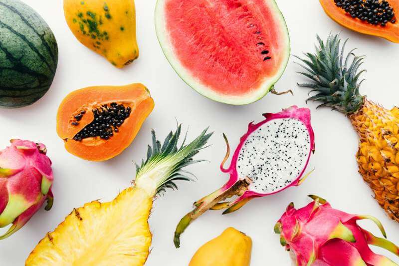 tropical-fruit-layout-made-of-dragon-fruit-watermelon-papaya-and-pineapple
